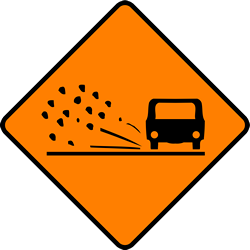 Traffic sign of Ireland: Warning for <a href='/en/ireland/overview/loose-chippings' target='_blank'>loose chippings</a> on the road surface