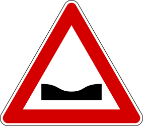 Traffic sign of Italy: Warning for a dip in the road