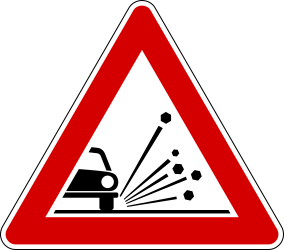 Traffic sign of Italy: Warning for loose chippings on the road surface