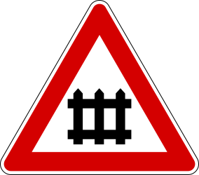 Traffic sign of Italy: Warning for a railroad crossing with barriers