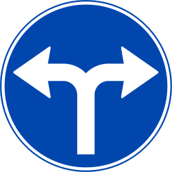 Traffic sign of Norway: Turning left or right mandatory