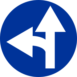 Traffic sign of Poland: Driving straight ahead or turning left mandatory
