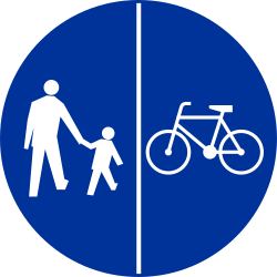 Traffic sign of Poland: Mandatory divided path for pedestrians and cyclists