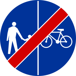 Traffic sign of Poland: End of the divided path for pedestrians and cyclists