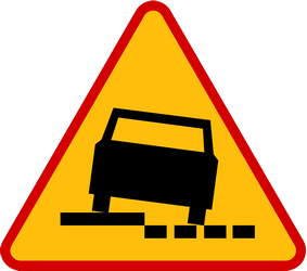Traffic sign of Poland: Warning for a soft verge