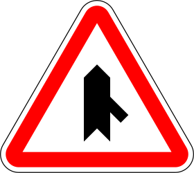 Traffic sign of Portugal: Warning for a crossroad with a sharp side road on the right