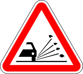 Traffic sign of Portugal: Warning for loose chippings on the road surface