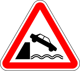 Traffic sign of Portugal: Warning for a quayside or riverbank