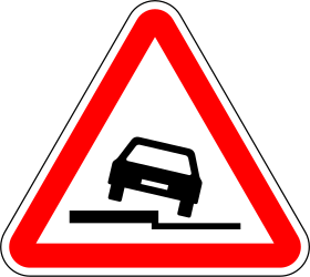Traffic sign of Portugal: Warning for a soft verge