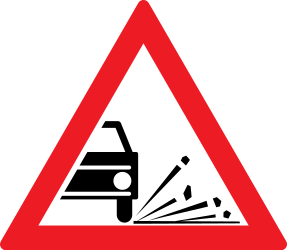 Traffic sign of Romania: Warning for loose chippings on the road surface