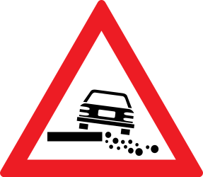 Traffic sign of Romania: Warning for a soft verge