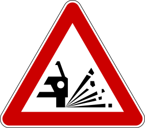 Traffic sign of Serbia: Warning for loose chippings on the road surface