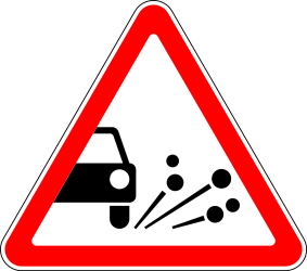 Traffic sign of Russia: Warning for loose chippings on the road surface