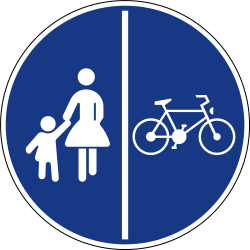 Traffic sign of Slovenia: Mandatory divided path for pedestrians and cyclists