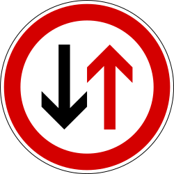 Traffic sign of Slovenia: Road narrowing, give way to oncoming drivers