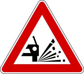 Traffic sign of Slovenia: Warning for loose chippings on the road surface