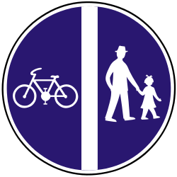Traffic sign of Slovakia: Mandatory divided path for pedestrians and cyclists
