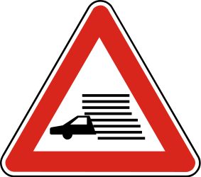 Traffic sign of Slovakia: Warning of poor visibility due to rain, fog or snow