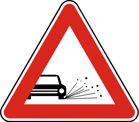 Traffic sign of Slovakia: Warning for loose chippings on the road surface