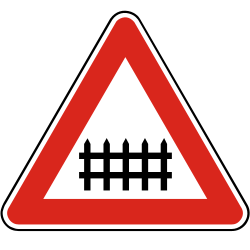 Traffic sign of Slovakia: Warning for a railroad crossing with barriers