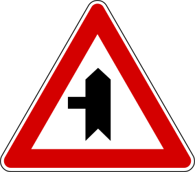 Traffic sign of Turkey: Warning for a crossroad with a side road on the left