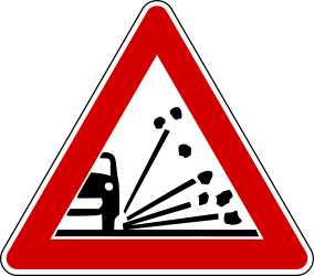 Traffic sign of Turkey: Warning for <a href='/en/turkey/overview/loose-chippings' target='_blank'>loose chippings</a> on the road surface