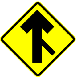 Traffic sign of Mexico: Warning for a crossroad with a sharp side road on the right