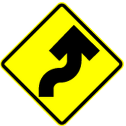 Traffic sign of Mexico: Warning for a <b>double curve</b>, first right then left