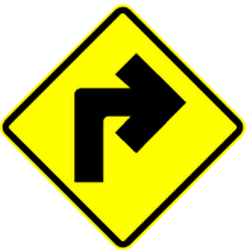 Traffic sign of Mexico: Warning for a <b>sharp curve</b> to the right