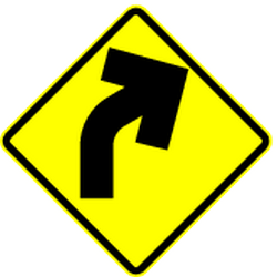 Traffic sign of Mexico: Warning for a <b>curve</b> to the right