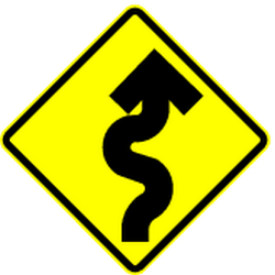 Traffic sign of Mexico: Warning for <b>curves</b>