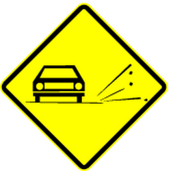 Traffic sign of Mexico: Warning for <a href='/en/mexico/overview/loose-chippings' target='_blank'>loose chippings</a> on the road surface