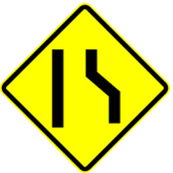 Traffic sign of Mexico: Warning for a road <b>narrowing</b> on the right
