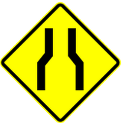 Traffic sign of Mexico: Warning for a road <b>narrowing</b>