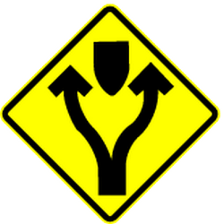 Traffic sign of Mexico: Warning for an obstacle, <b>pass</b> either side