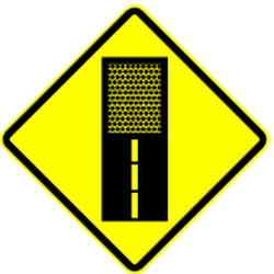 Traffic sign of Mexico: Warning for an <a href='/en/mexico/overview/dirt-road'>unpaved road surface</a>