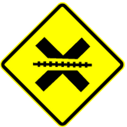 Traffic sign of Mexico: Warning for a <a href='/en/mexico/overview/railroad-crossing'>railroad crossing</a> <b>without</b> <a href='/en/mexico/overview/barrier'>barriers</a>