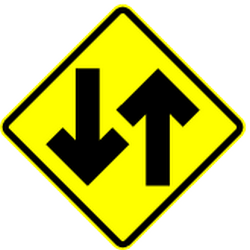 Traffic sign of Mexico: Warning for a road with <b>two-way traffic</b>