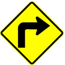 Traffic sign of Panama: Warning for a sharp curve to the right