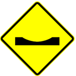 Traffic sign of Panama: Warning for a dip in the road