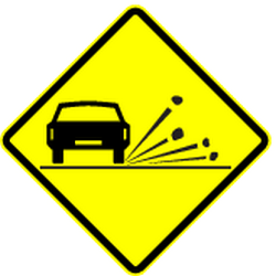 Traffic sign of Panama: Warning for loose chippings on the road surface