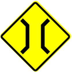 Traffic sign of Panama: Warning for a narrowing