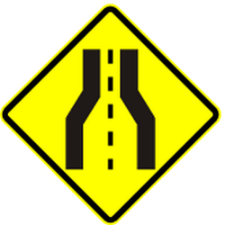 Traffic sign of Panama: Warning for a road narrowing