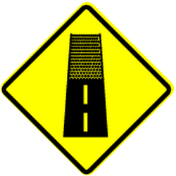 Traffic sign of Panama: Warning for an unpaved road surface