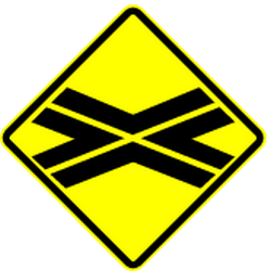 Traffic sign of Panama: Warning for a railroad crossing without barriers