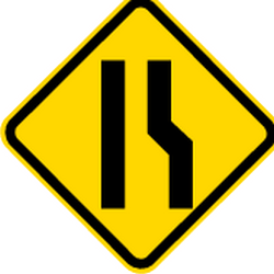 Traffic sign of Brazil: Warning for a road narrowing on the right