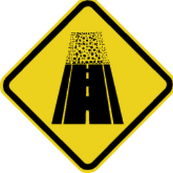 Traffic sign of Brazil: Warning for an <a href='/en/brazil/overview/dirt-road'>unpaved road surface</a>