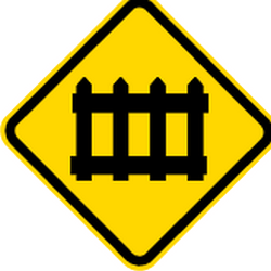 Traffic sign of Brazil: Warning for a railroad crossing with barriers
