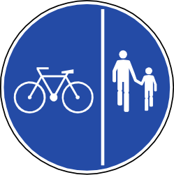 Traffic sign of Chile: Mandatory divided path for pedestrians and cyclists