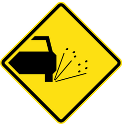 Traffic sign of Chile: Warning for loose chippings on the road surface
